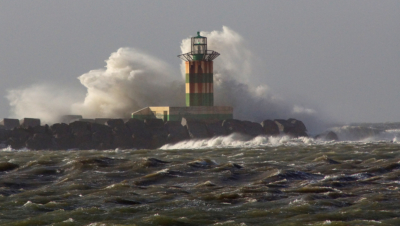 Storm at the IJmuiden harbour entrance shot from a mile away